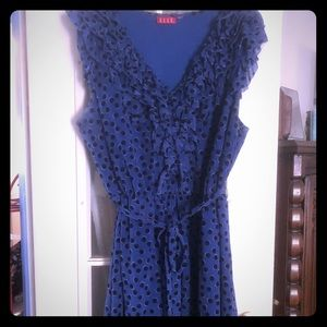 Blue with black polka dots and frilly sleeves
